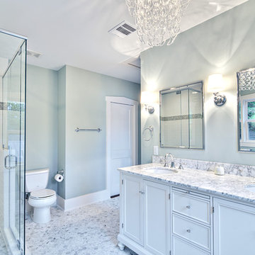 Spa-like master bath with glass chandelier and pedestal tub