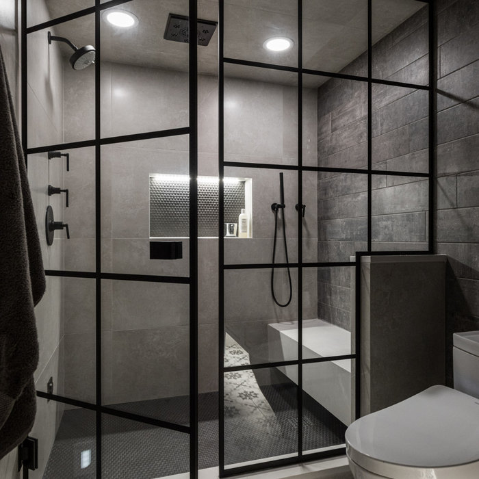 Example of a mid-sized urban beige tile and porcelain tile porcelain tile and multicolored floor sauna design in Detroit with shaker cabinets, black cabinets, a one-piece toilet, gray walls, an underm