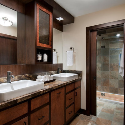 Bathroom - large contemporary multicolored tile and slate tile slate floor bathroom idea in San Francisco with a vessel sink, furniture-like cabinets, medium tone wood cabinets, marble countertops, a one-piece toilet and beige walls
