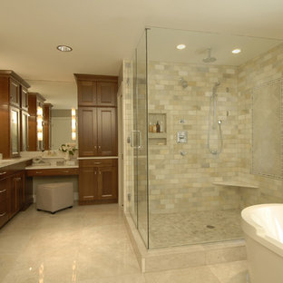 Example of a classic beige tile and marble tile bathroom design in Raleigh with recessed-panel cabinets and medium tone wood cabinets