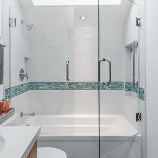 Small beach style master blue tile and ceramic tile ceramic floor and blue floor bathroom photo in San Francisco with shaker cabinets, brown cabinets, a two-piece toilet, blue walls, an undermount sink, quartz countertops and a hinged shower door