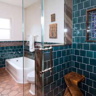 Photo of a medium sized mediterranean ensuite bathroom in Los Angeles with a submerged sink, shaker cabinets, medium wood cabinets, quartz worktops, a corner bath, a corner shower, a one-piece toilet, blue tiles, ceramic tiles, white walls and terracotta flooring.