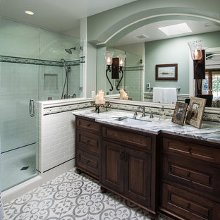 Example of a mid-sized tuscan master ceramic tile and gray tile ceramic floor corner shower design in Los Angeles with an undermount sink, marble countertops, green walls, furniture-like cabinets and dark wood cabinets