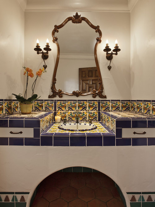 Bathroom - mediterranean multicolored tile and ceramic tile terra-cotta  floor bathroom idea in Santa