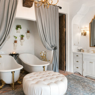 Inspiration for a mid-sized mediterranean master white tile and porcelain tile terra-cotta floor bathroom remodel in Jacksonville with shaker cabinets, white cabinets, a drop-in sink, marble countertops and white walls