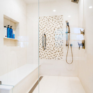 Tuscan master white tile limestone floor and white floor alcove shower photo in Los Angeles with white walls, an undermount sink and a hinged shower door