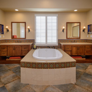 Inspiration for a large mediterranean master beige tile and multicolored tile porcelain floor drop-in bathtub remodel in Los Angeles with beige walls, an undermount sink, quartzite countertops, shaker cabinets and medium tone wood cabinets