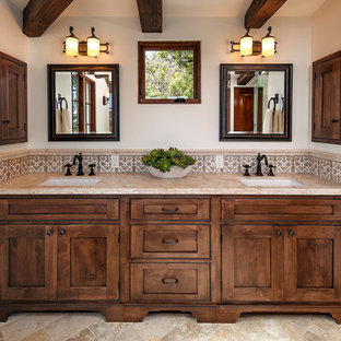 Design ideas for a large mediterranean ensuite bathroom in Santa Barbara with a submerged sink, recessed-panel cabinets, medium wood cabinets, a freestanding bath, a walk-in shower, beige tiles, ceramic tiles and beige walls.