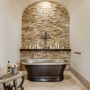 Mid-sized tuscan master beige tile and porcelain tile porcelain floor bathroom photo in Dallas with an undermount sink, raised-panel cabinets, dark wood cabinets, granite countertops, a one-piece toilet and beige walls