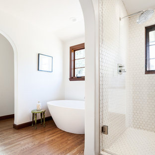 Bathroom - mediterranean master white tile and mosaic tile medium tone wood floor and brown floor bathroom idea in Sacramento with white walls and a hinged shower door