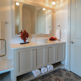 Photo of a large mediterranean family bathroom in Austin with shaker cabinets, white cabinets, a built-in shower, a two-piece toilet, grey tiles, cement tiles, white walls, cement flooring, a vessel sink, engineered stone worktops, grey floors and a hinged door.