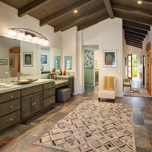 Southwest ceramic tile and green tile multicolored floor bathroom photo in San Diego with shaker cabinets, dark wood cabinets, white walls, a vessel sink, tile countertops and green countertops