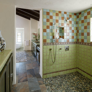 Bathroom - southwestern master ceramic tile and multicolored tile pebble tile floor and multicolored floor bathroom idea in San Diego with shaker cabinets, dark wood cabinets, white walls, tile countertops and green countertops