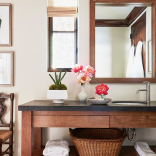 Large tuscan master terra-cotta floor and red floor bathroom photo in Los Angeles with dark wood cabinets, white walls, an undermount sink, white countertops, open cabinets and concrete countertops