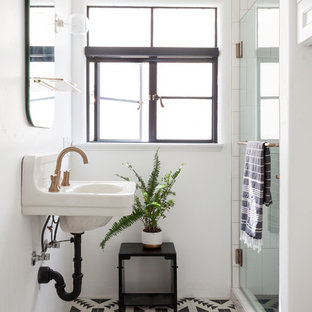 Example of a tuscan 3/4 cement tile floor and multicolored floor alcove shower design in Sacramento with white walls, a wall-mount sink and a hinged shower door