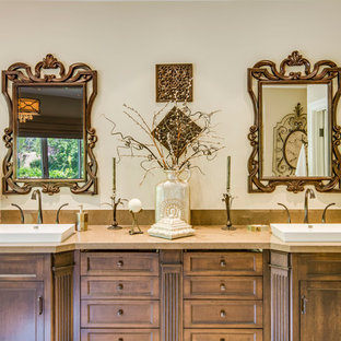 Large mediterranean ensuite bathroom in Los Angeles with a vessel sink, recessed-panel cabinets, medium wood cabinets, laminate worktops and white walls.