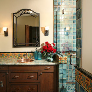 Design ideas for a large mediterranean bathroom in Los Angeles with a drop-in sink, dark wood cabinets, an alcove shower, blue tile, shaker cabinets, granite benchtops, white walls, terra-cotta floors and orange floor.