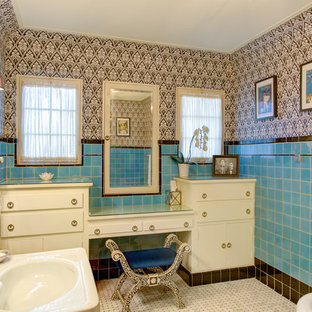Mid-sized tuscan master blue tile, brown tile and ceramic tile mosaic tile floor and multicolored floor freestanding bathtub photo in Los Angeles with flat-panel cabinets, white cabinets, multicolored walls, an integrated sink, glass countertops and a wall-mount toilet