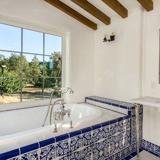 Example of a tuscan bathroom design in San Francisco with marble countertops and a console sink