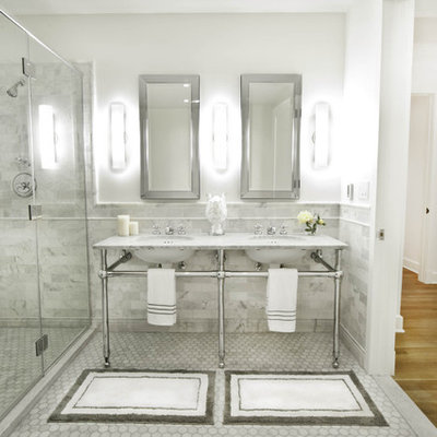 Bathroom - large traditional master subway tile and gray tile marble floor and gray floor bathroom idea in New York with open cabinets, a one-piece toilet, white walls, a pedestal sink, marble countertops, a hinged shower door and gray countertops