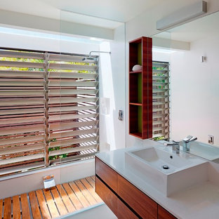 Inspiration for a contemporary walk-in shower remodel in Sunshine Coast with a vessel sink, flat-panel cabinets, medium tone wood cabinets and white walls