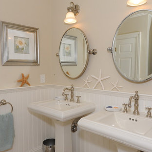 Medium sized nautical family bathroom in New York with beige walls and a pedestal sink.