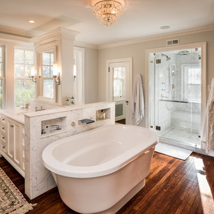 Example of a classic master dark wood floor bathroom design in Philadelphia with recessed-panel cabinets, white cabinets, gray walls, an undermount sink and a hinged shower door