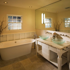 Traditional Bathroom by interior Lighting and Design
