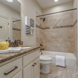 Design ideas for a medium sized mediterranean family bathroom in Houston with recessed-panel cabinets, white cabinets, an alcove bath, an alcove shower, a one-piece toilet, beige tiles, ceramic tiles, beige walls, cement flooring, a submerged sink, granite worktops, beige floors and a shower curtain.