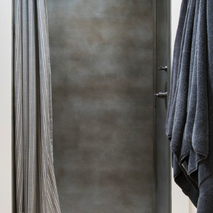 Small country shower room in Other with a walk-in shower, grey tiles, metal tiles, beige walls, multi-coloured floors and a shower curtain.