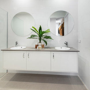 Inspiration for a large midcentury master bathroom in Canberra - Queanbeyan with white cabinets, a corner shower, white tile, ceramic tile, white walls, cement tiles, a drop-in sink, granite benchtops, beige floor, an open shower, grey benchtops and flat-panel cabinets.