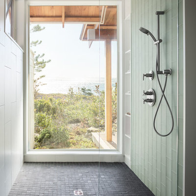 Walk-in shower - large contemporary master white tile and porcelain tile slate floor walk-in shower idea in Portland Maine with flat-panel cabinets, green cabinets, a wall-mount toilet, white walls, an undermount sink and granite countertops