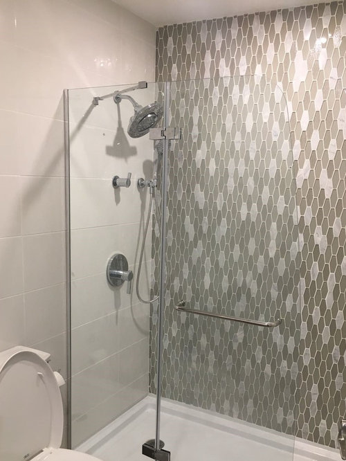 contemporary bathroom in other with an alcove shower beige tile and mosaic tile