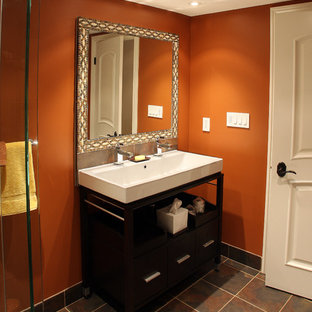 Example Of A Clic Bathroom Design In Toronto With Trough Sink And Orange Walls