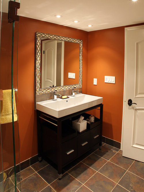 example of a classic bathroom design in toronto with a trough sink and orange walls