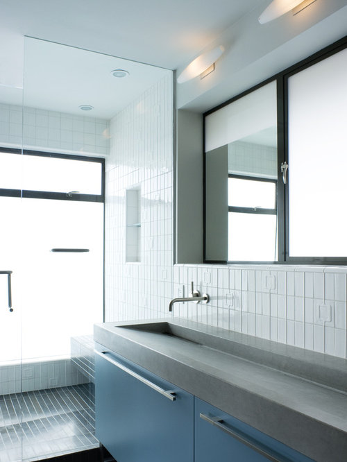 Inspiration for a modern white tile bathroom remodel in San Francisco with  a trough sink,