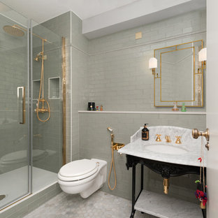 Large classic shower room bathroom in London with recessed-panel cabinets, white cabinets, a one-piece toilet, white tiles, metro tiles, a console sink, a built-in shower, grey walls, marble flooring, grey floors, a hinged door and grey worktops.