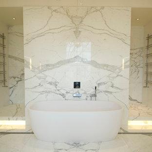 Bathroom - contemporary marble tile bathroom idea in London