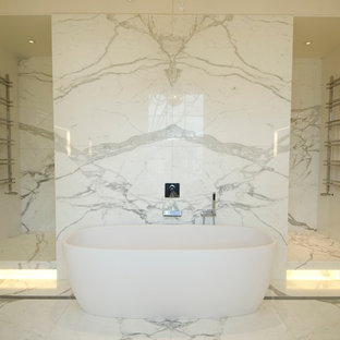This is an example of a contemporary bathroom in London with marble.