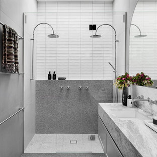 Design ideas for a contemporary bathroom in Melbourne with shaker cabinets, grey cabinets, a double shower, gray tile, white tile, an undermount sink, grey floor, a hinged shower door and grey benchtops.