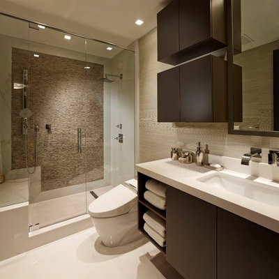 Alcove shower - contemporary beige tile alcove shower idea in Miami with flat-panel cabinets and dark wood cabinets