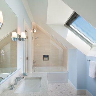 Photo of a nautical family bathroom in Portland Maine with an alcove bath, an alcove shower, beige tiles, blue walls and pebble tile flooring.