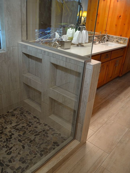 Example Of A Small Mountain Style Master Pebble Tile Laminate Floor And  Beige Floor Corner Shower