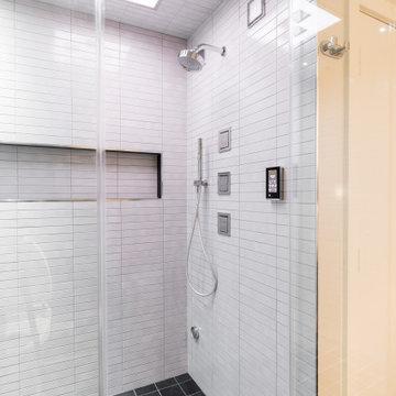 Stand up Shower featuring Kohler Shower Panel, Jets, Handshower and Speakers