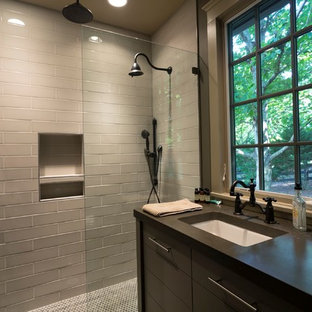 Example of a mid-sized transitional 3/4 gray tile and subway tile mosaic tile floor and multicolored floor alcove shower design in Nashville with flat-panel cabinets, gray cabinets, concrete countertops, gray walls, an undermount sink and a hinged shower door