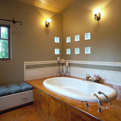 Example of an eclectic subway tile concrete floor drop-in bathtub design in Seattle