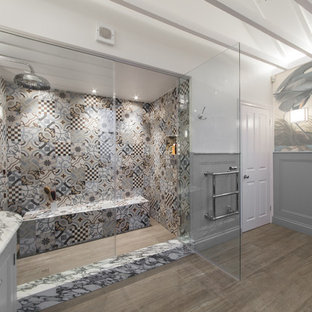 Large eclectic kids' multicolored tile and porcelain tile porcelain floor bathroom photo in London with recessed-panel cabinets, gray cabinets, a two-piece toilet, multicolored walls, a drop-in sink and marble countertops