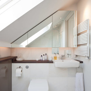 Inspiration for a small contemporary bathroom in London with wooden worktops, white tiles, stone tiles and a one-piece toilet.