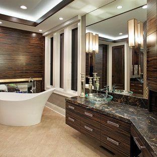 Design ideas for a contemporary ensuite bathroom in Minneapolis with granite worktops, a freestanding bath, ceramic flooring, a vessel sink, flat-panel cabinets and dark wood cabinets.