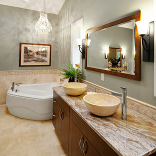 Transitional bathroom in Vancouver with a freestanding tub, a vessel sink and green walls.